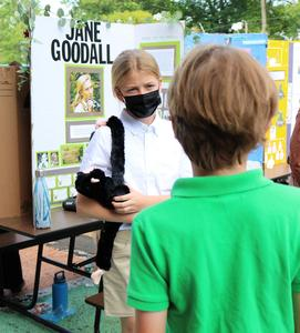 Photo of Wilson 5th grader dressed as Jane Goodall and answering questions.
