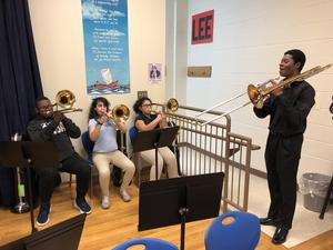 Trombone students with instructor