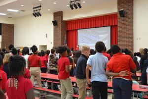 students saying Pledge of Allegiance