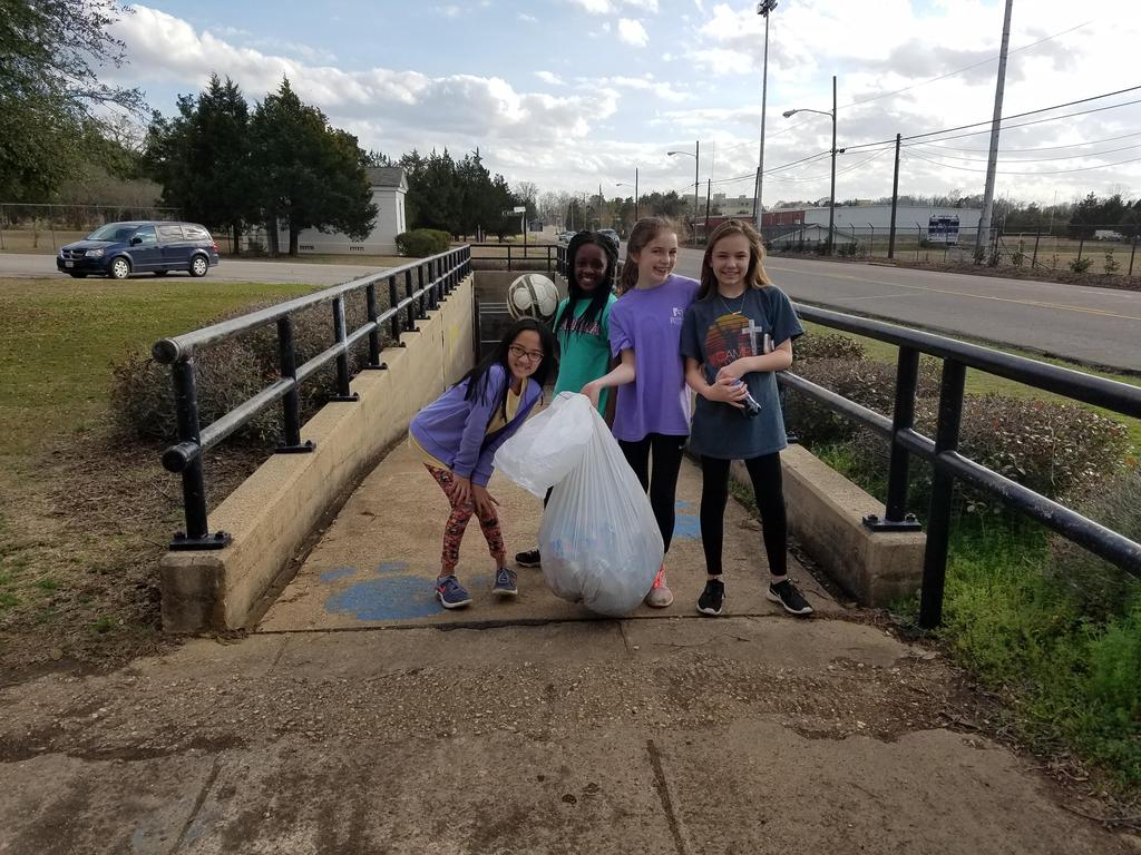DMS betas pick up trash around the football field