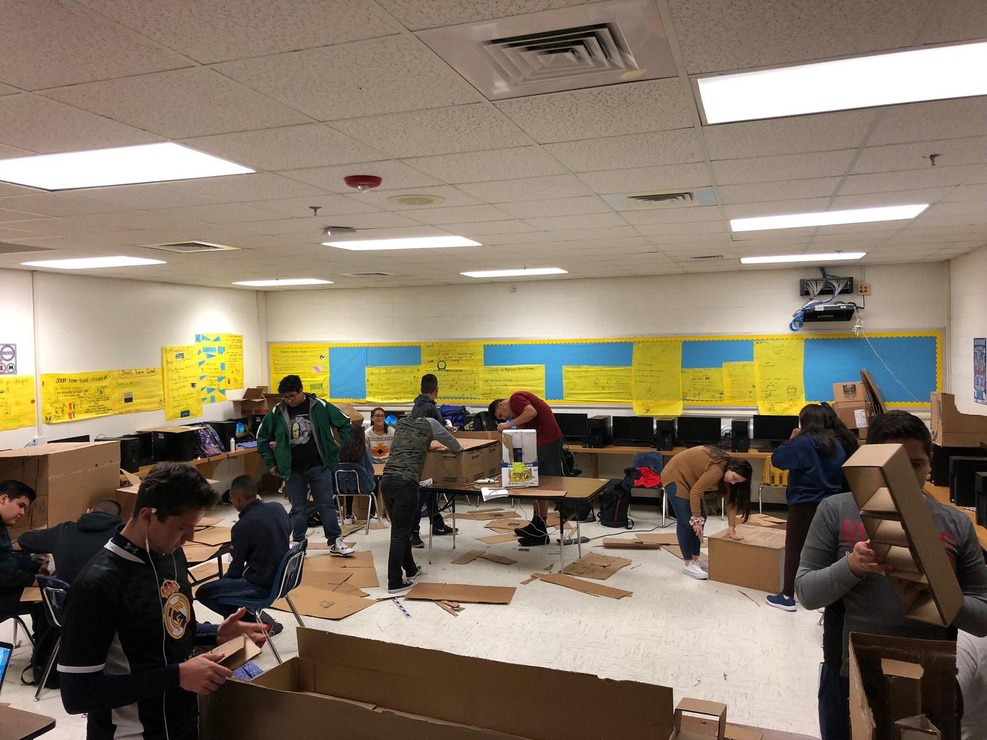 students engineering furniture from cardboard