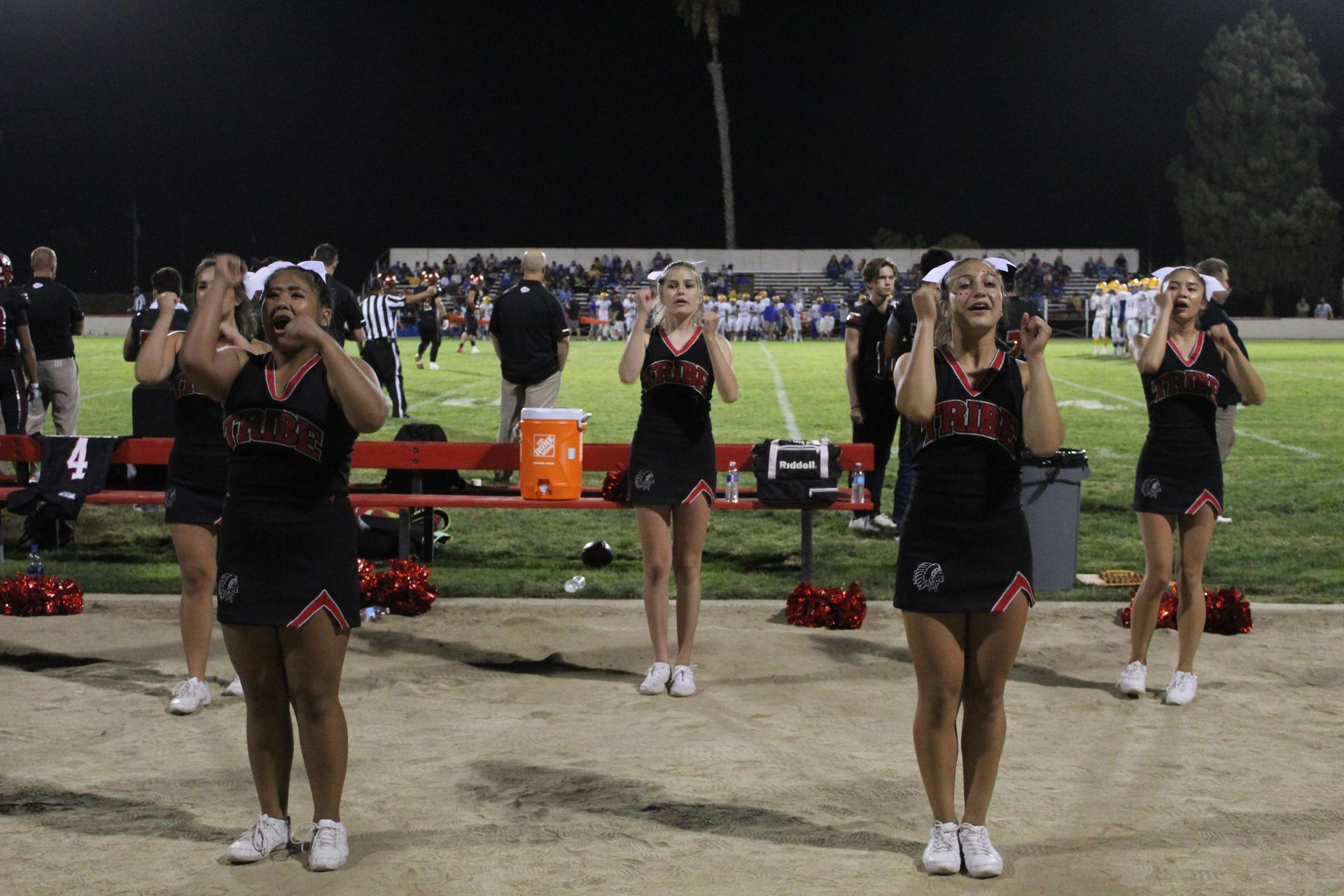 Fans, Cheerleaders, Motorcycles at Dos Palos football game