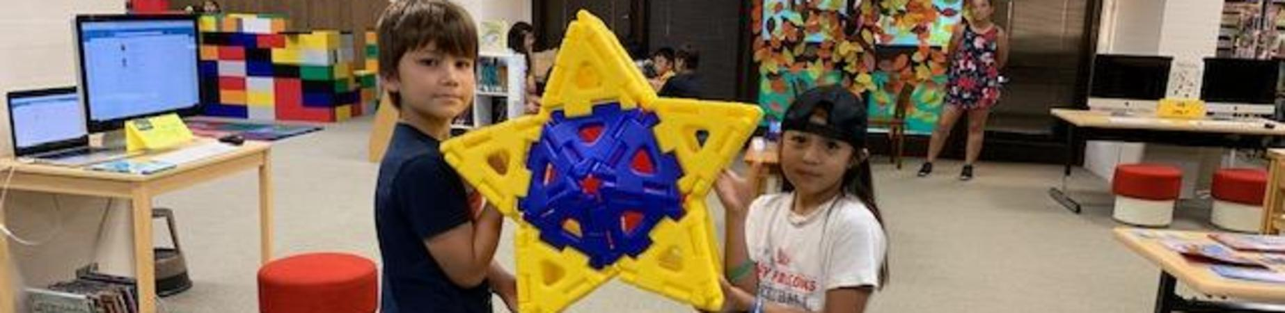 Library Free Time - Look What I Made - 2 students holding up star shape