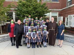 Kiara Zani, Fr. Fitzgerald, Fr. Chris, Fr. O'Malley, Jen Kowieski, STCPS students.jpg