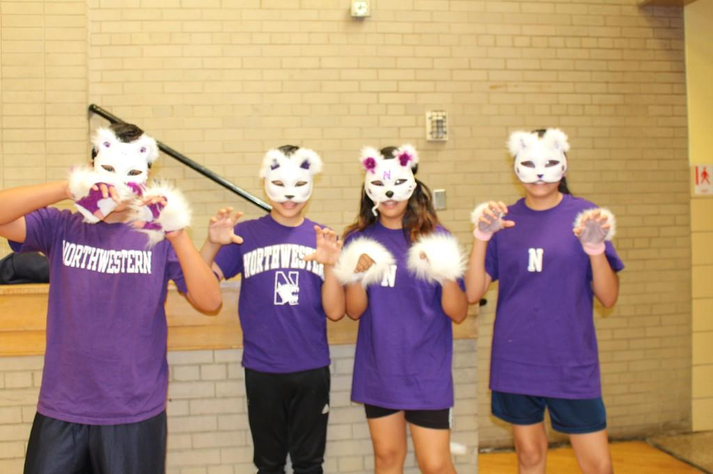 8th graders dressed as Northwestern wildcats for their cheer