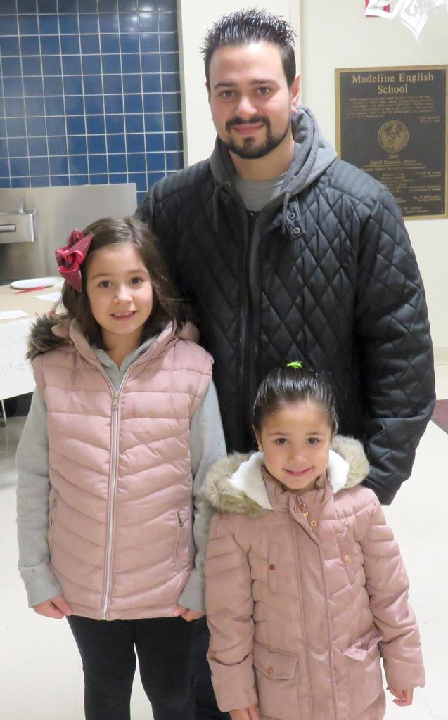 A father and his two daughters arrive at the English School for Polar Express Night