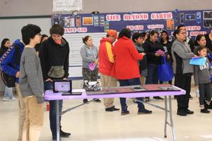 Students and parents gathering at the beginning of the Lairon Showcase.
