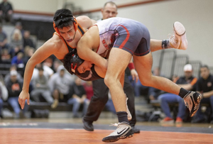 photo of two students wrestling