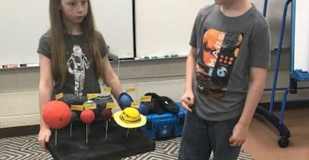 Gifted students present solar system model