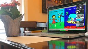 laptop on kitchen table on Ms. Florez Zoom