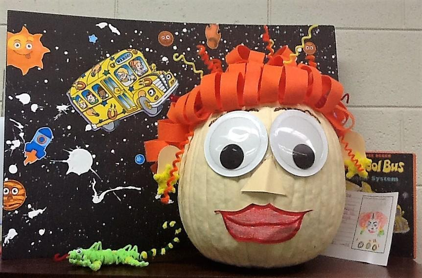 pumpkin painted like Mrs. Frizzle