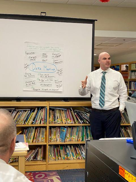 Assistant Principal Dennis Lynch talks to his colleagues
