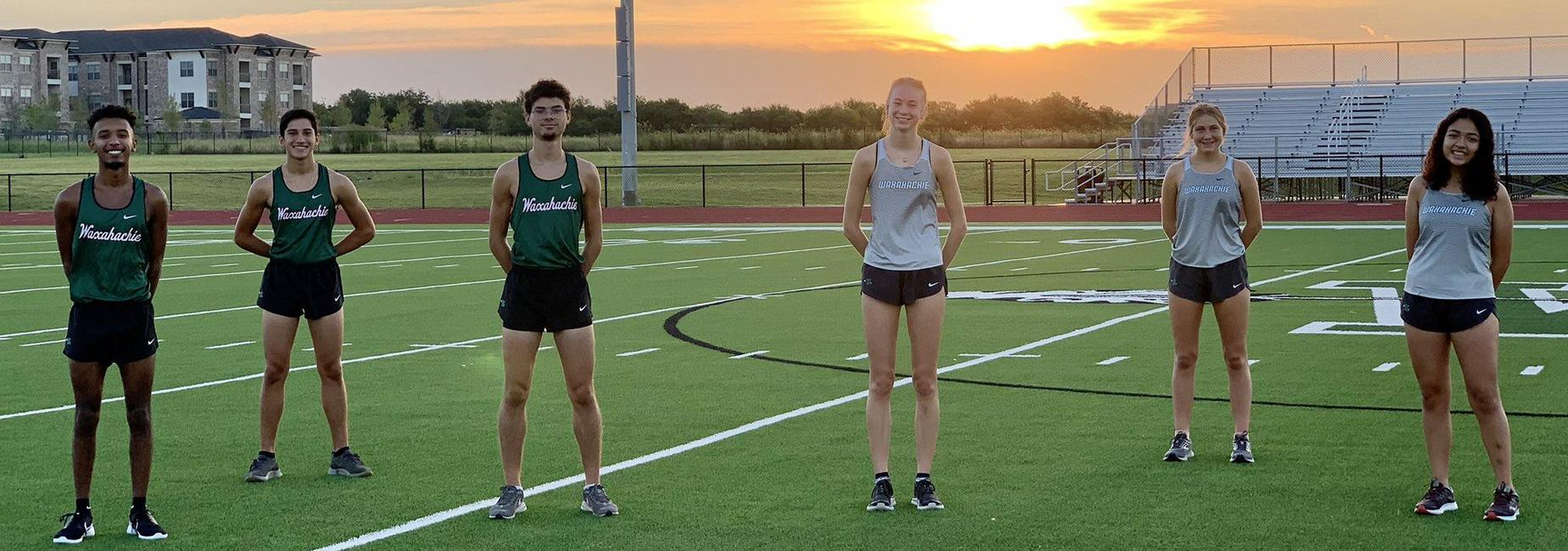3 boys & 3 girls cross country athletes on the field at sunrise
