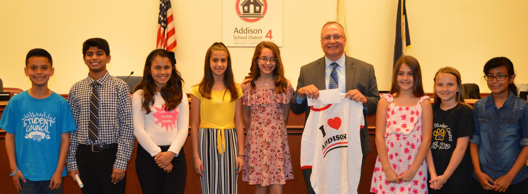 Student Council Presidents present Dennis Reboletti with donation for Addison Township Pantry