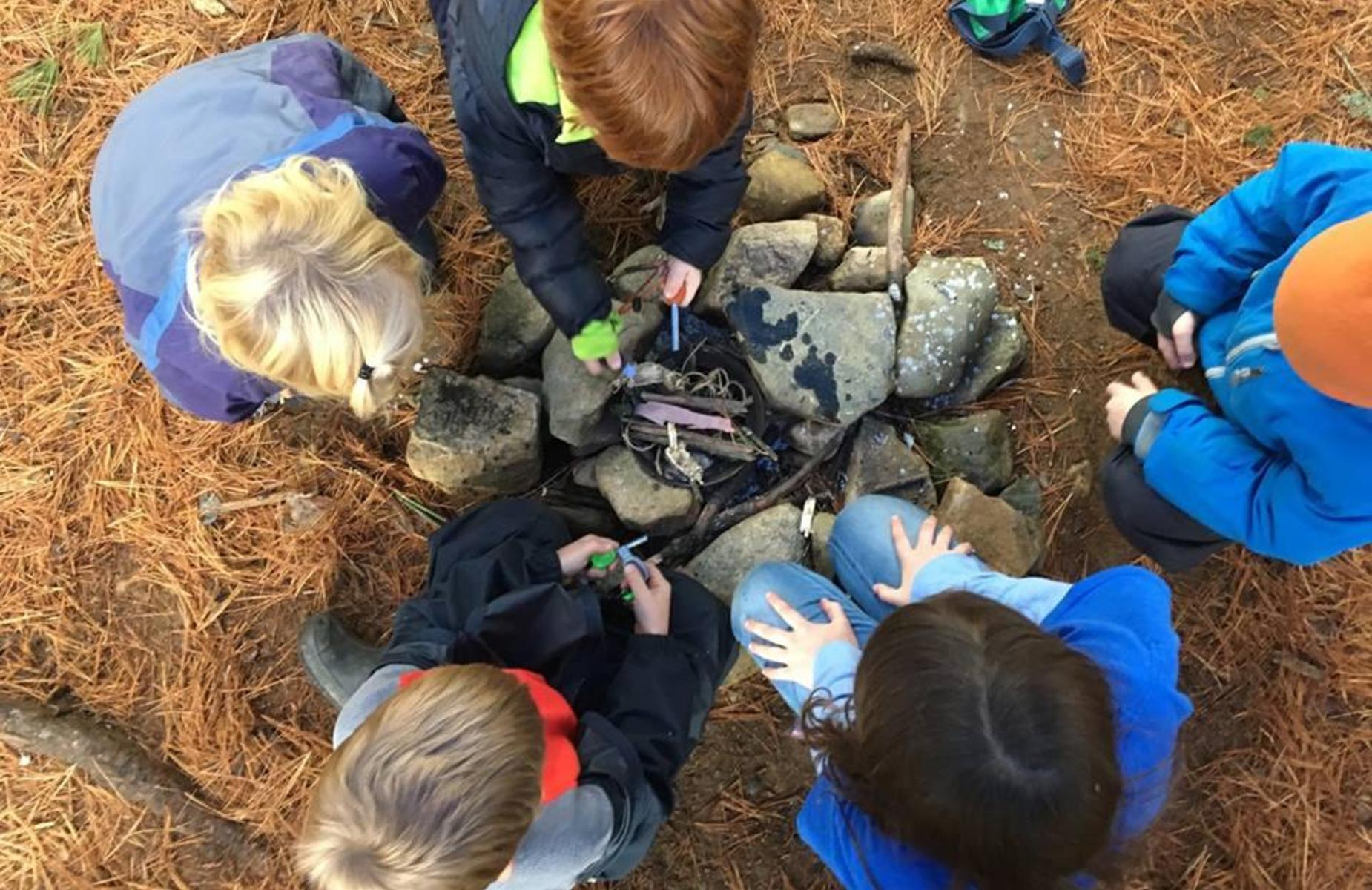 students building a camp fire