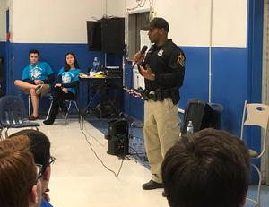 Photo of:  :  At the annual Guy & Girl Thing at Westfield High School on March 22, School Resource Officer and WHS alumnus Ricardo Johnson spoke about overcoming personal struggles but ultimately being able to find success in life.
