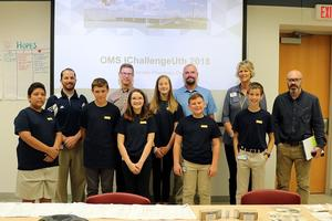 OMS student pose with Mr. McCallum, AAESA's Amy Oliver and Parker Hannifin reps.