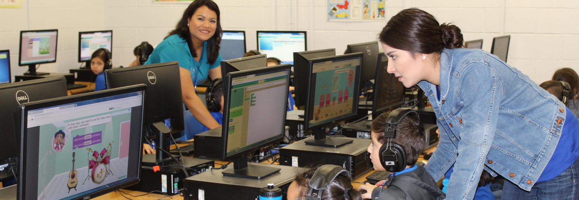students and teachers in the computer lab