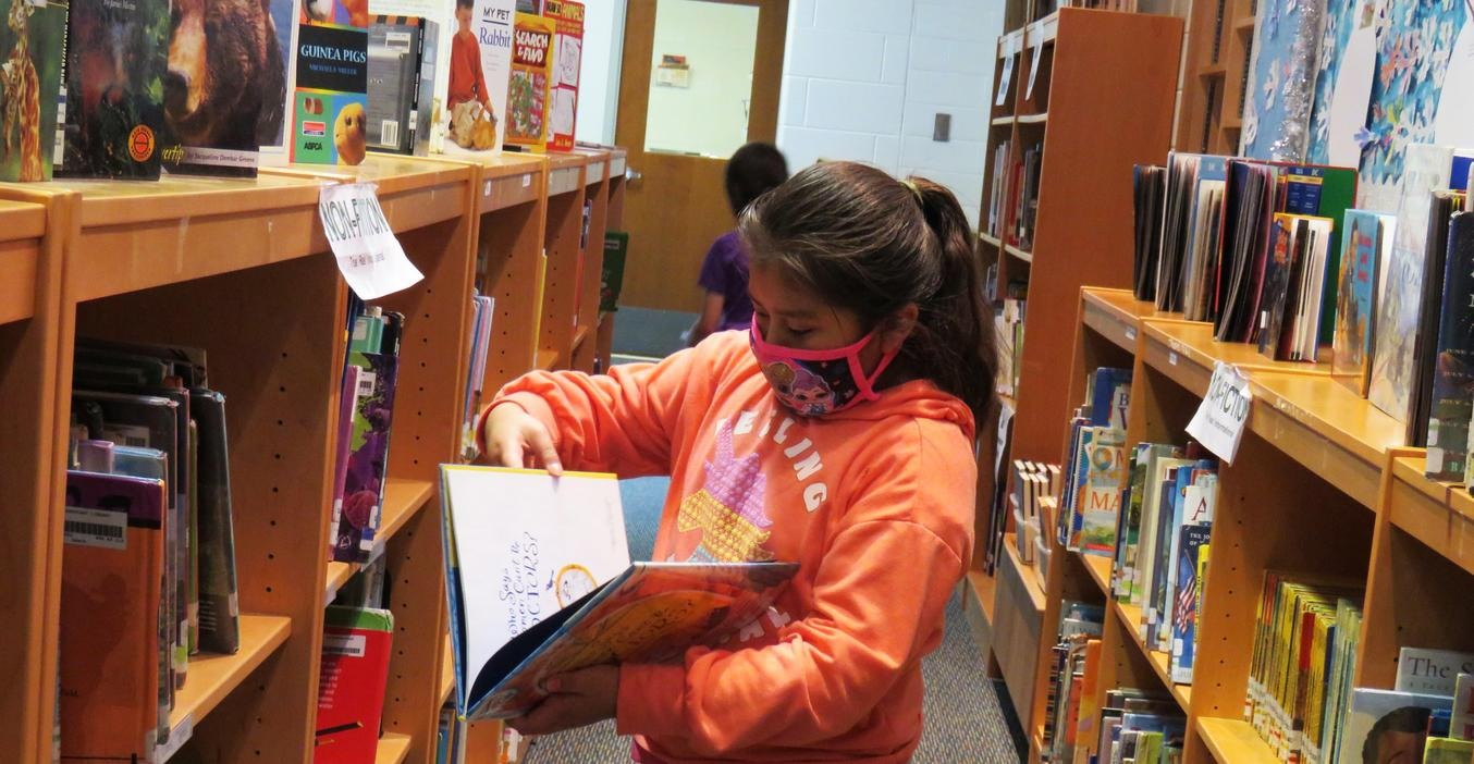 Lee students check out books at the library.