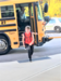 student exiting the school bus