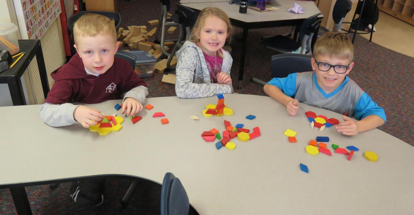 McFall kindergarten students learn with math blocks.