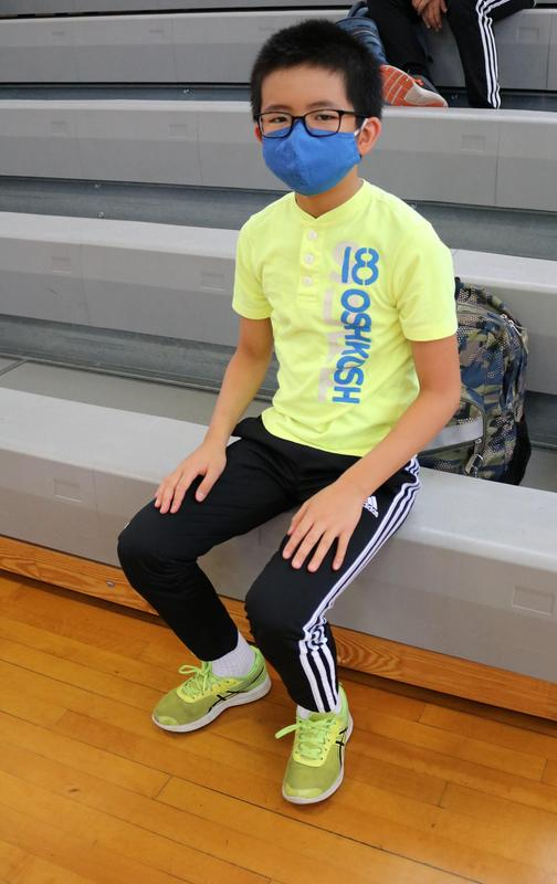 Photo of Edison student donning sneakers to