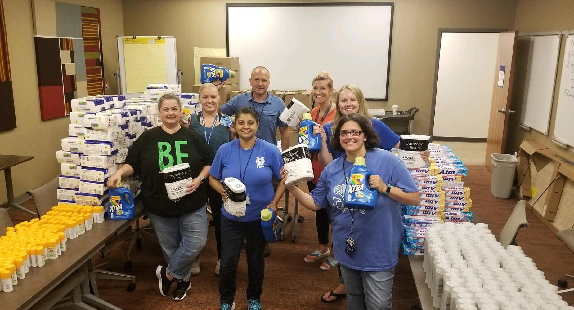 Success Liaisons assigned to Hamilton City Schools work to gather and categorize personal care and hygiene items for donations