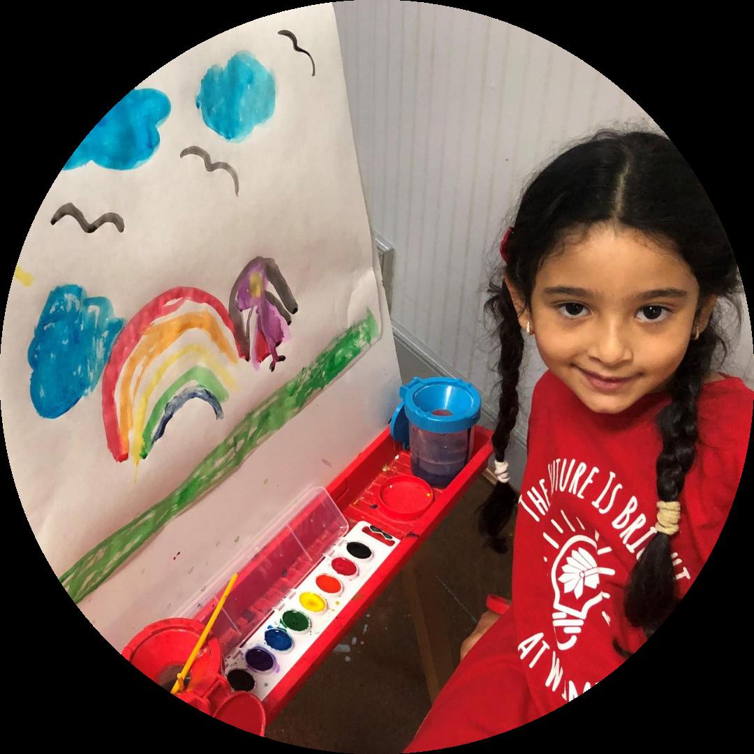 girl posing beside watercolor painting
