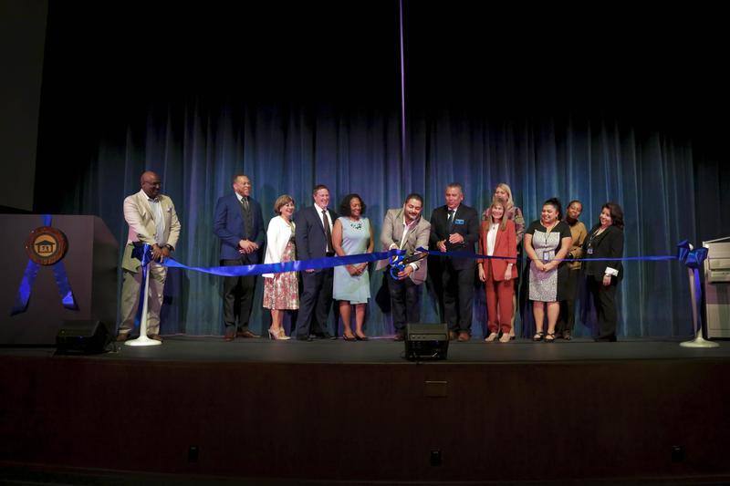 School Board and Administration pictured cutting the ceremonial ribbon during the grand re-opening