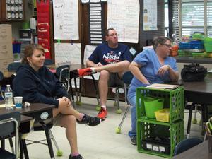 Parents observe math talks in the classroom.