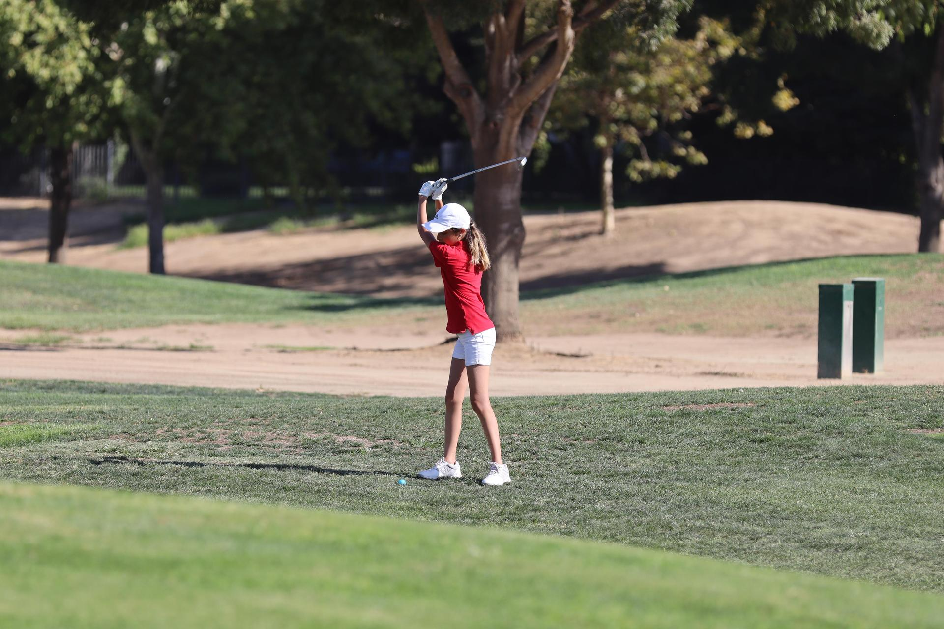 Girls playing golf against Madera South