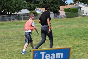 kids walking on field