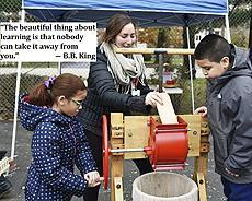 "Image of student making apple cider ""The beautiful thing about learning is that nobody can take it away from you."" -B.B. King"