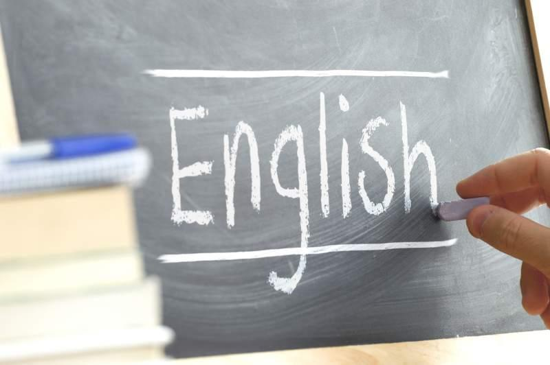 A Chalkboard with the word English written on in.