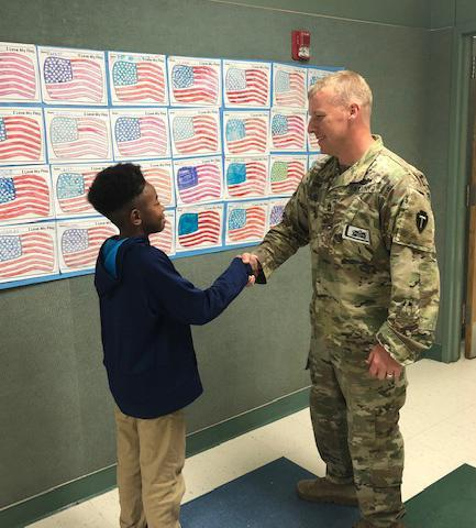 A Marti Elementary student greeting a soldier