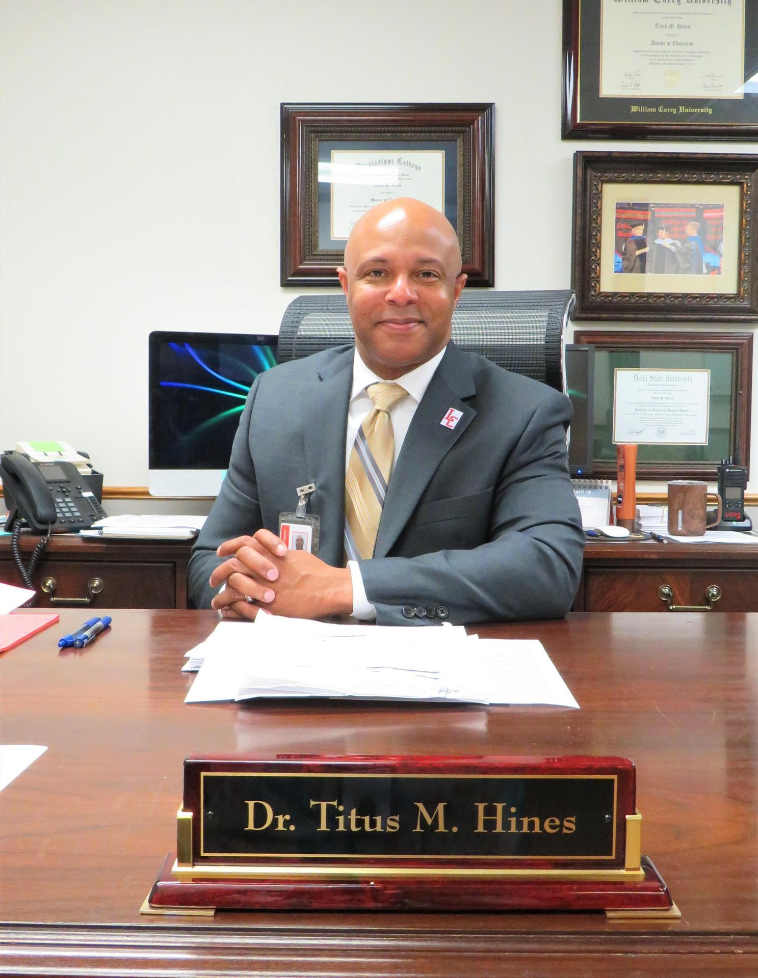 Dr. Titus M. Hines, Superintendent