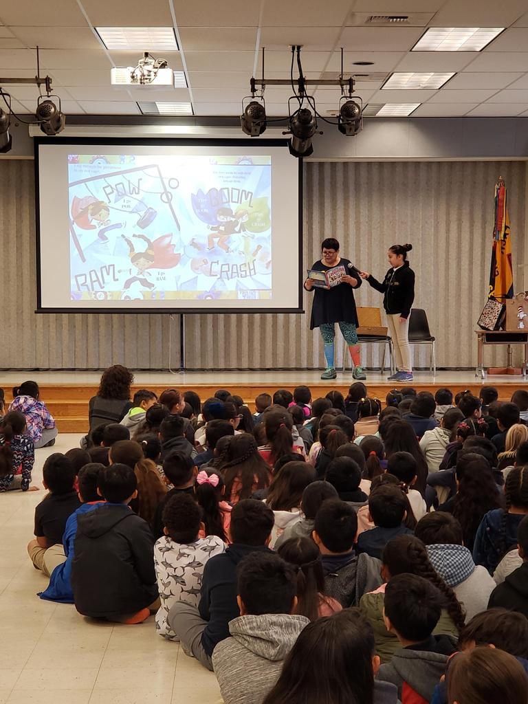 librarian Christina Cervantes reads Luchadora book to Santee students