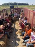 Miss Reid's class at Tuttle Orchard picking apples and learning about how apples go from farm to grocery store.