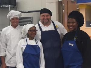 Chef with students posing for a picture