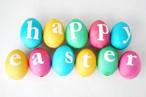 Colored Easter eggs with the letters saying Happy Easter on them.