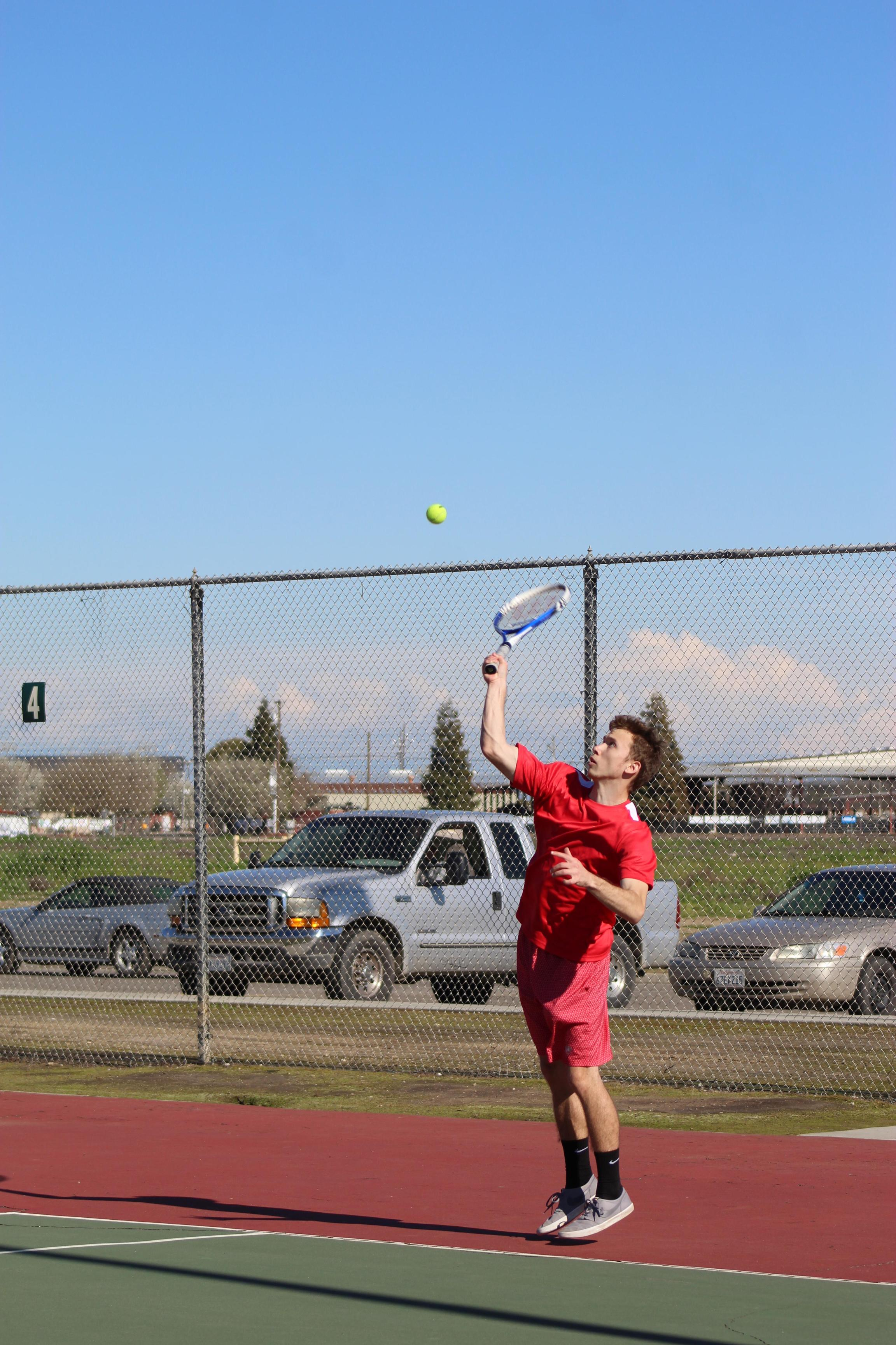 Boys playing tennis against Yosemite