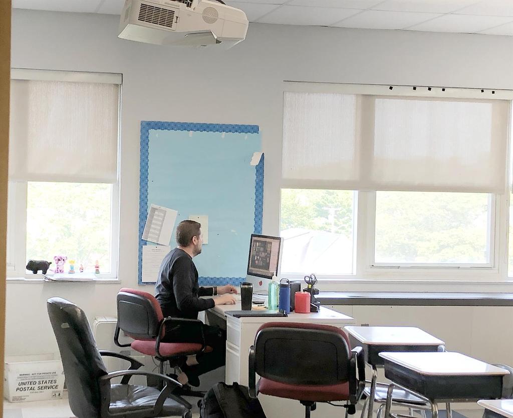 Teacher at his desk