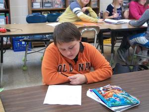 A student wears orange for