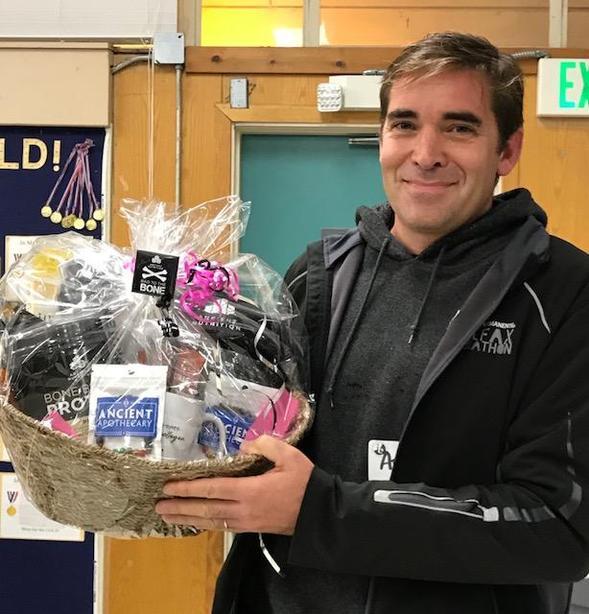 Man holding gift basket