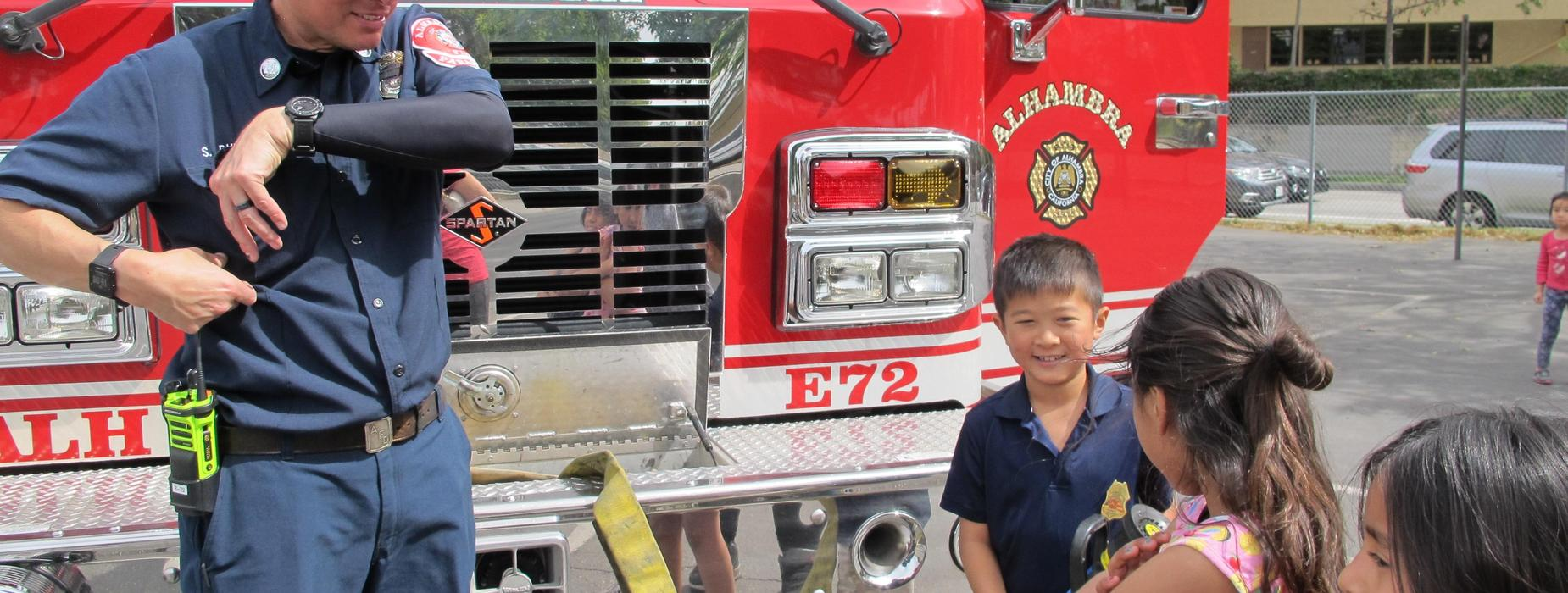 Marguerita students and Alhambra firefighter during school event