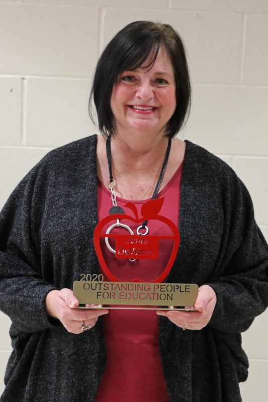 Judie with award