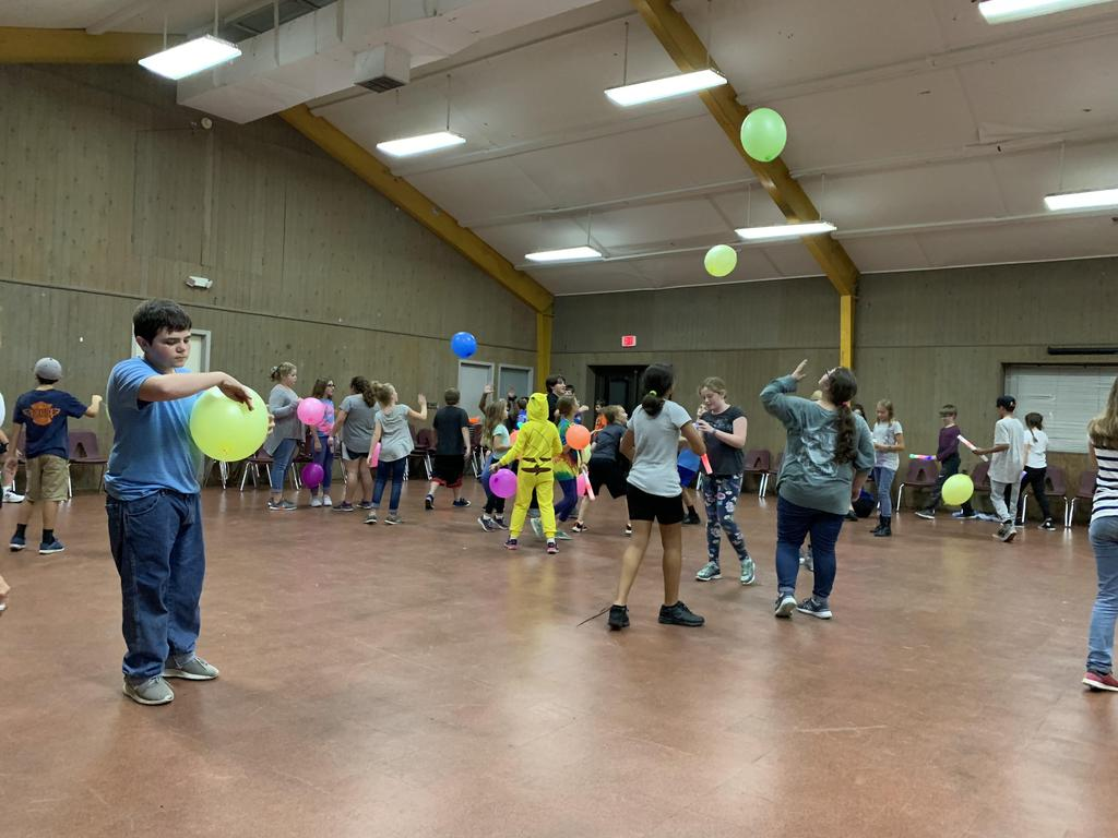 Students playing with balloons