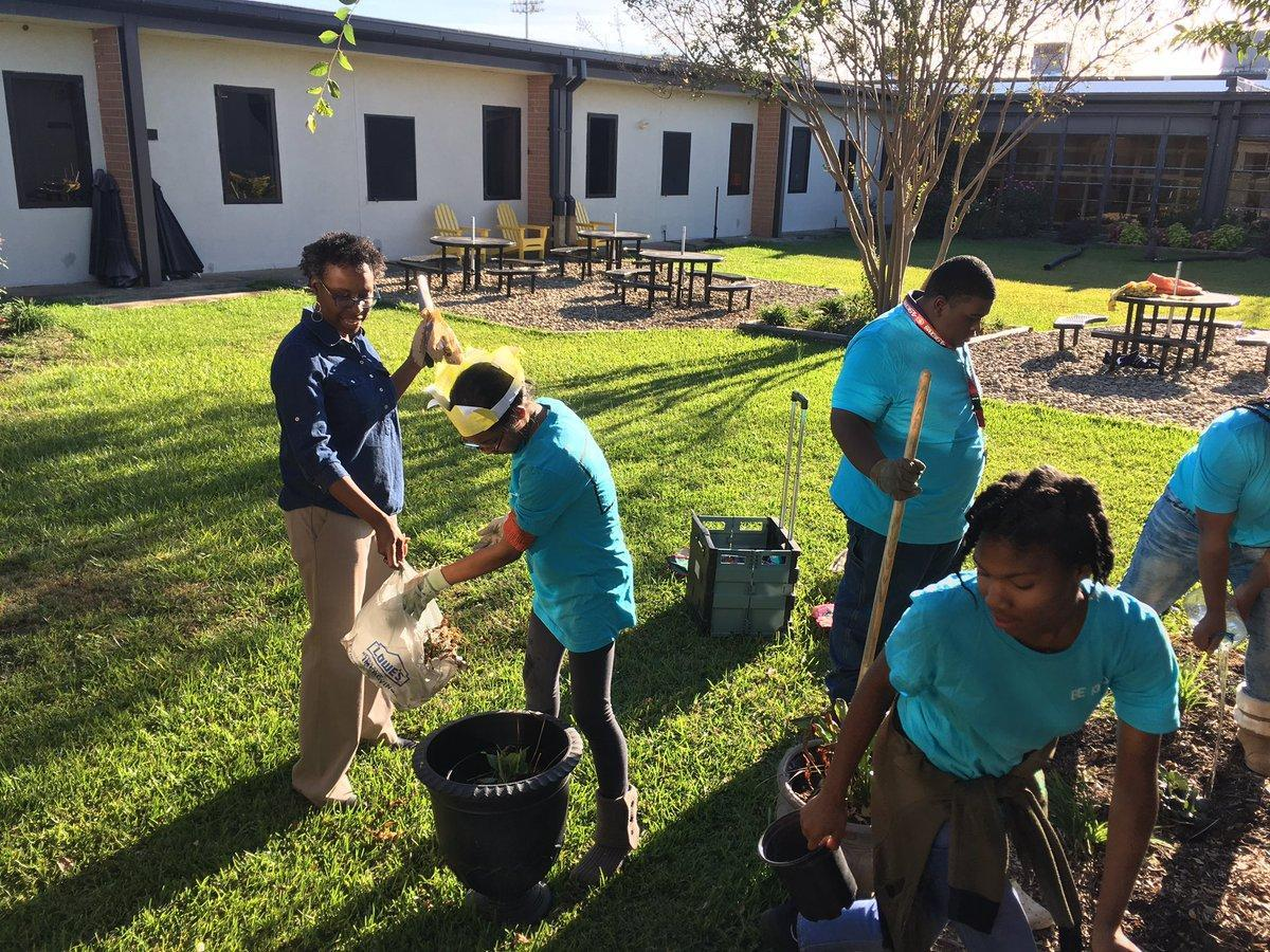 Students planting flowers