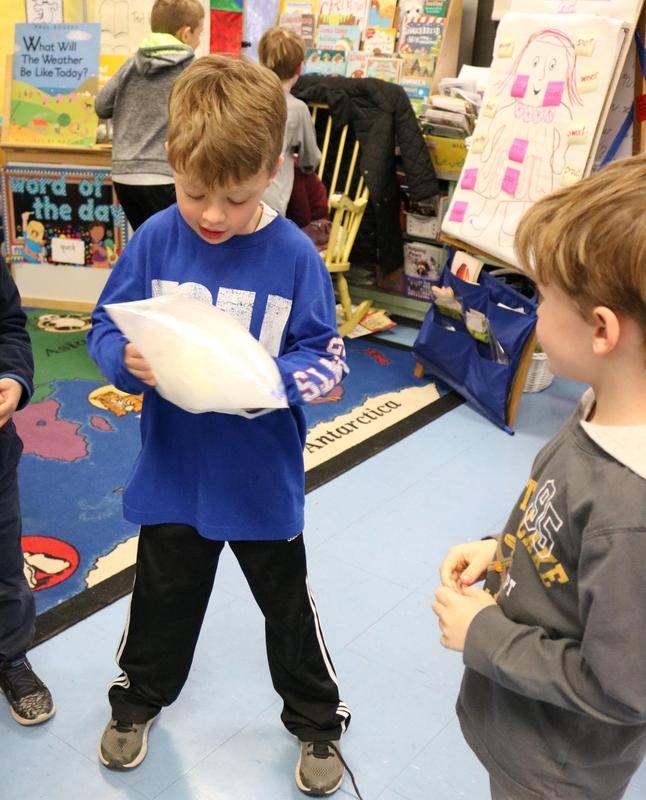 Wilson 1st graders make ice cream during a recent afterschool STEAM session.