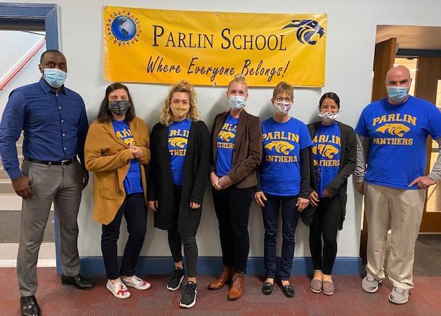 Staff, posed photo, wearing blue